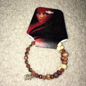 """Jewelry - Women at Risk Bracelet with """"Love"""" Charm"""